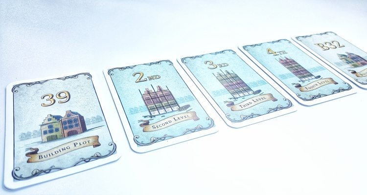 Kickstarter preview of Chartered The Golden Age player pieces hand cards in numbers and heights