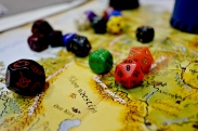 We love these style maps and these dice. Those are the bones of our board game passion.