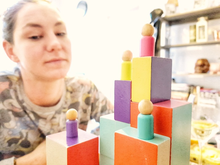 Board games are fun with Capstone Games The Climbers and Simply Complex. Player pieces and stacks of blocks