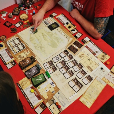 Robinson Crusoe by Portal Games. Brutal and beautiful, just like nature.