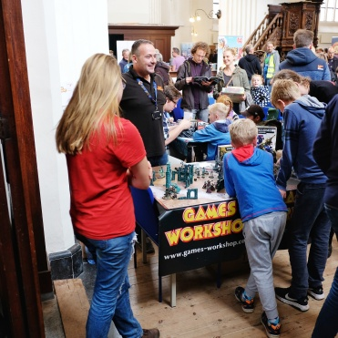 Kids and miniatures are always a success. Lovely little booth from Games Workshop and stellar painting on the miniatures.